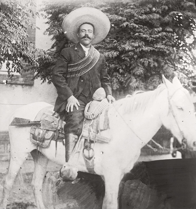 jose doroteo arango, or pancho villa, on a horse